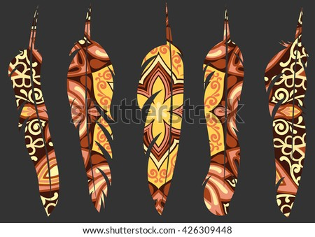set of five decorative feathers with pattern in yellow and brown colors