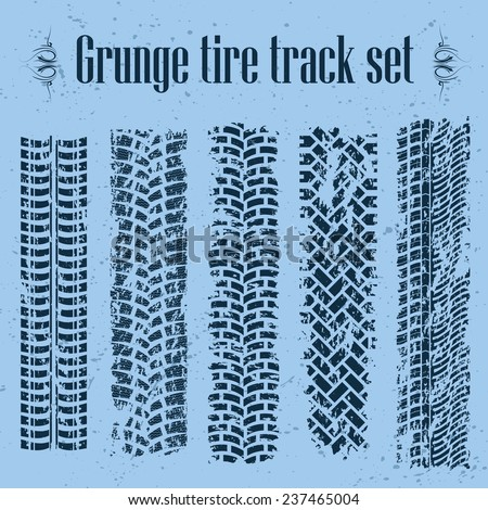 Set of five tire track silhouette on blue. eps10 - stock vector