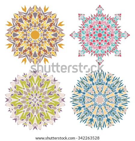 Set of four geometric eastern round ornaments mandalas isolated over white - stock vector
