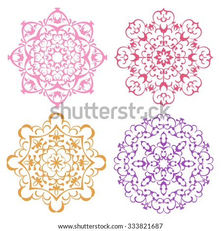 Set of four warm color lacy eastern round ornaments mandalas isolated over white