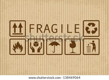Set of fragile symbols on grunge cardboard - stock vector