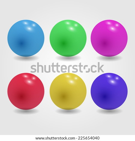Set of glossy colored balls on grey background.