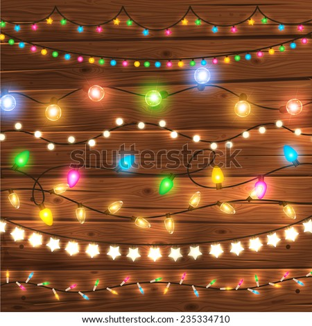 Set of Glowing Christmas Lights for Xmas Holiday Greeting Cards Design. Wooden Hand Drawn Background. Light Bulbs Collection. - stock vector