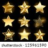Set of gold, fine stars on a black background. - stock vector