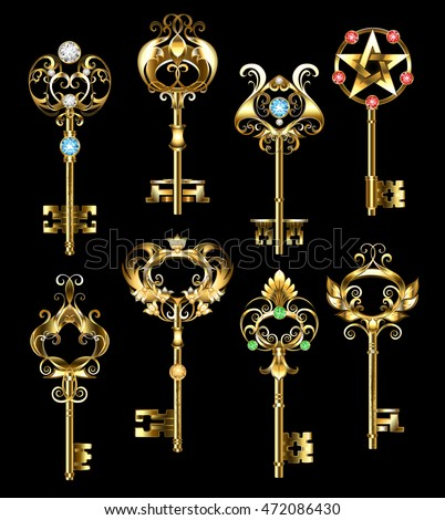 Set of gold, jewelry keys, decorated with round gems on black background. Jewelry gold keys.
