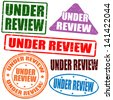 Set of grunge rubber stamps with the text under review written inside, vector illustration - stock photo