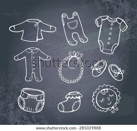 Set of hand-drawn doodle icons baby clothes and accessories on a blackboard. - stock vector