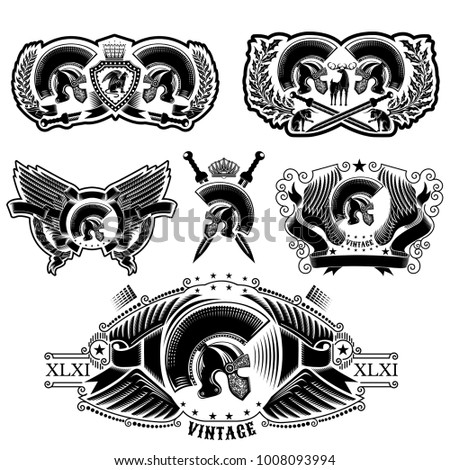 Set of labels with Spartan helmets, wreathes, sword and wing. Heraldic vintage elements isolated on white
