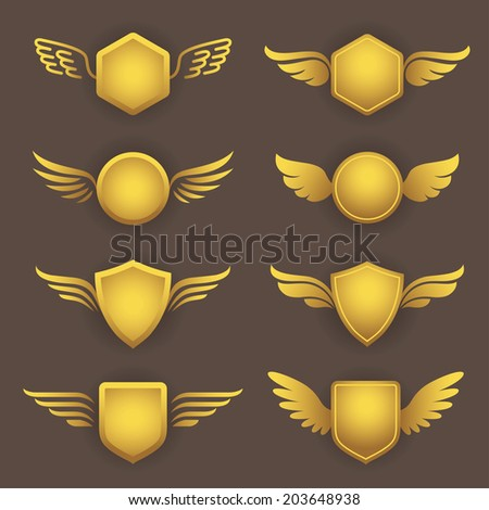 Set of modern heraldic shapes with wings in golden colors - stock vector