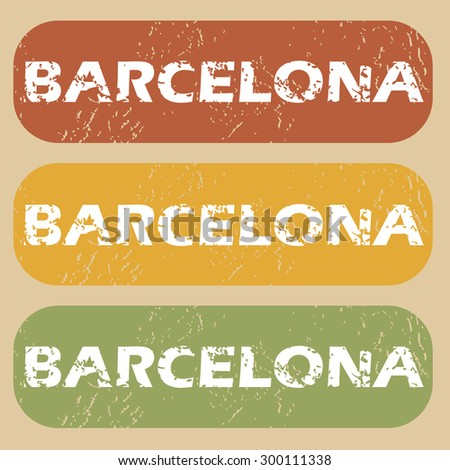 Set of rubber stamps with city name Barcelona on colored background - stock vector