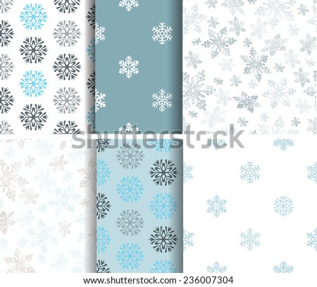 Set of seamless  blue winter patterns with snowflakes - stock vector