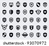 Set of 35 shield icons with various medieval and modern symbols - stock vector