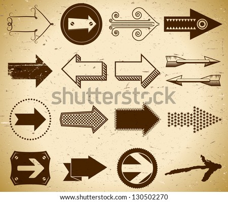 Set of trendy vintage arrows on grungy paper - stock vector