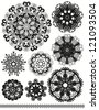 Set of vector decorative rosettes, snowflakes, monochrome elements - stock vector