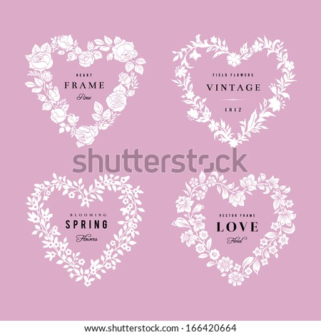 Set of vector floral frames in the shape of heart. Four White silhouettes of flowers on a pink background. Design elements. - stock vector