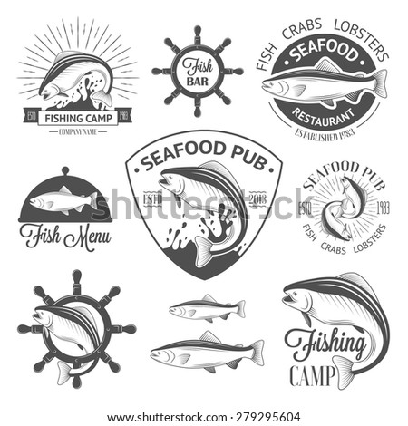 Set of vintage fish logos with helm, sunburst and salmons - stock vector