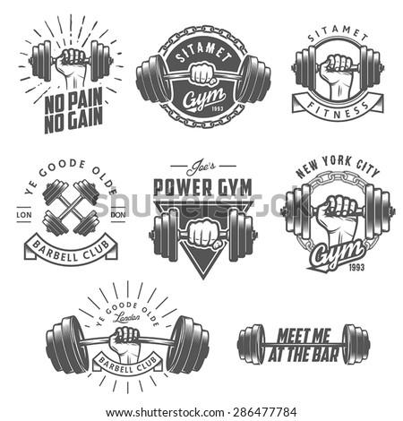 Set of vintage gym emblems, labels and design elements - stock vector