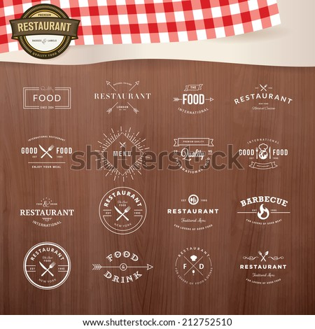 Set of vintage style elements for labels and badges for restaurants, with wood texture and elements of restaurant inventory in the background  - stock vector