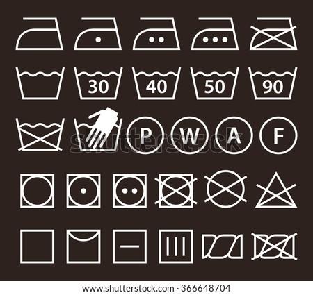 Set of washing symbols (Laundry icons) on dark background - stock vector
