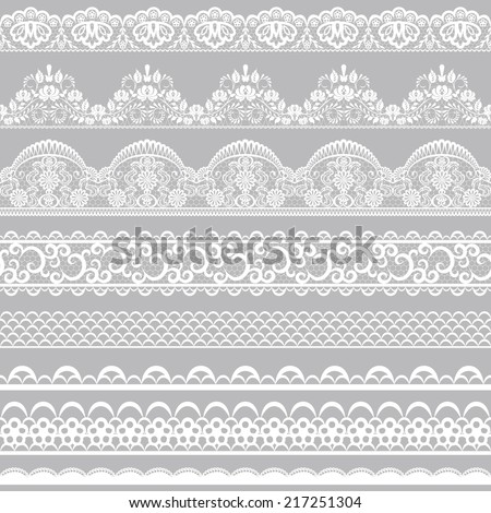 Set of white lace borders isolated on gray background - stock vector