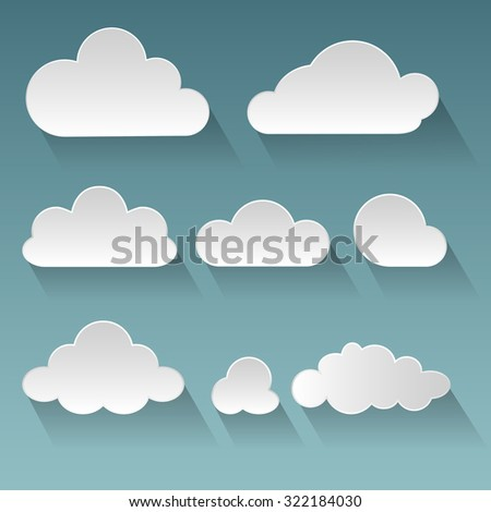 Set of white paper clouds with flat shadows on a blue background
