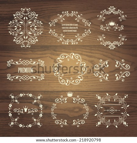 set of white retro styled ornamental designs. frames with crowns for your photo or sample text. isolated on wooden background. vector illustration. can use for birthday card, wedding invitations  - stock vector