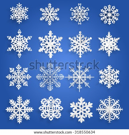 Set of white snowflakes cut out of paper