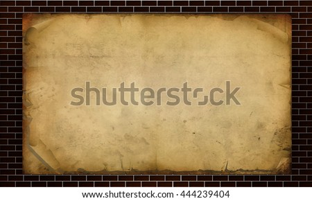 Sheets of parchment against the backdrop of a brick wall
