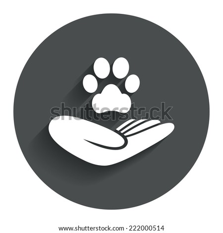 Shelter pets sign icon. Hand holds paw symbol. Animal protection. Circle flat button with shadow. Modern UI website navigation. Vector - stock vector
