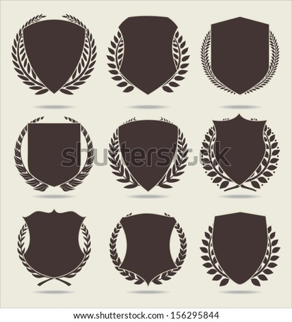 Shield and laurel wreath - stock vector