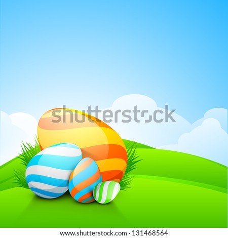 Shiny colorful Easter eggs on nature background.