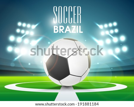 Shiny soccer ball in full stadium lights at night with stylish text brazil 2014. - stock vector