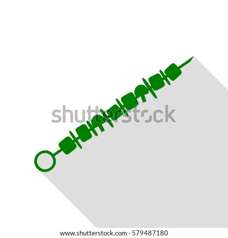 Shish kebab on skewers sign. Green icon with flat style shadow path.