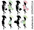 Silhouette moms to be under umbrellas - stock vector