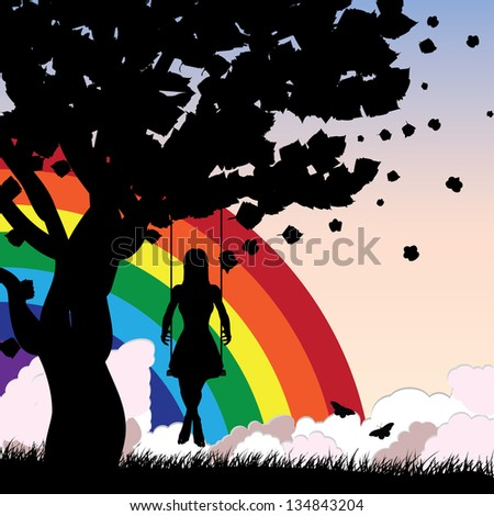 Silhouette of a girl sitting on a swing under the tree on rainbow background.