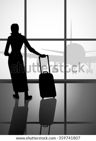 Silhouette of a woman with luggage looking at the airport window