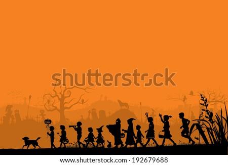 Silhouette of children playing on Halloween night