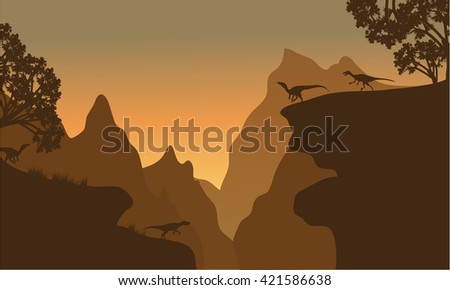 Silhouette of eoraptor in cliff with brown backgrounds