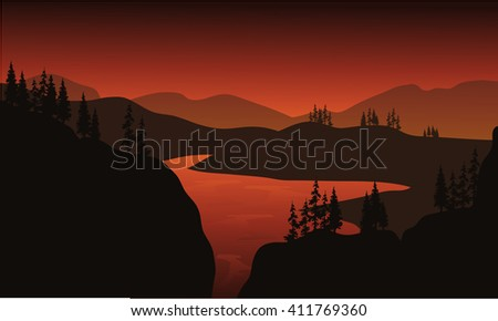 Silhouette of lake with brown backgrounds at the sunrise