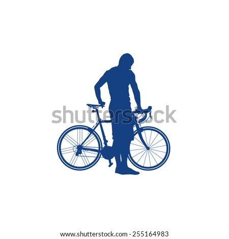Silhouette of man holding a bicycle