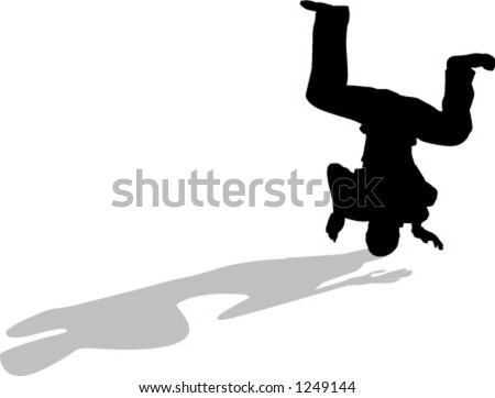 silhouette of person breakdancing