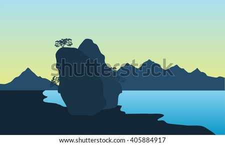 Silhouette of the beach and big rock