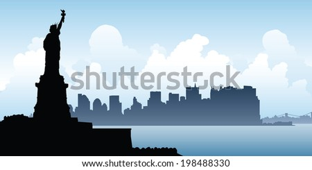 Silhouette of the Statue of Liberty looks over the skyline of Lower Manhattan.