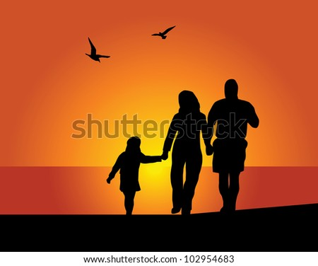 Silhouettes of the parents and children on a background of the evening sky