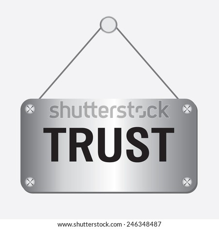 silver metallic trust sign hanging on the wall