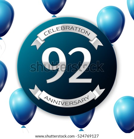 Silver number ninety two years anniversary celebration on blue circle paper banner with silver ribbon. Realistic blue balloons with ribbon on white background. Vector illustration.