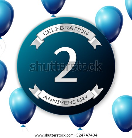 Silver number two years anniversary celebration on blue circle paper banner with silver ribbon. Realistic blue balloons with ribbon on white background. Vector illustration.