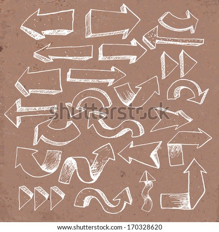 Sketch arrow collection for your design. Hand drawn on brown paper. Vector illustration.  - stock vector