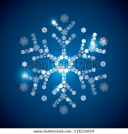 snowflake consisting of a scattering of scintillating shining snowflakes - stock vector