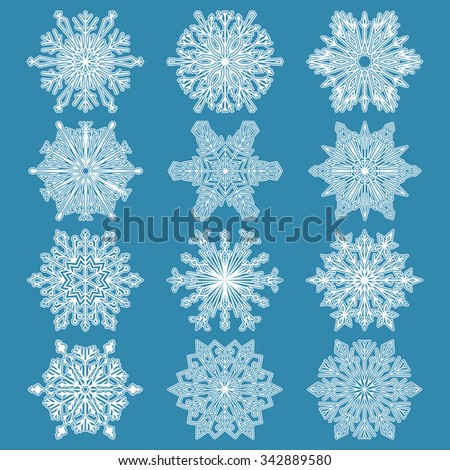 Snowflakes icon collection-1.  White snowflakes on a blue background. Graphic vector ornament